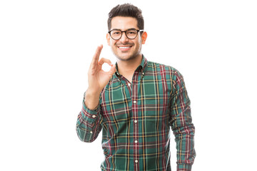 Fashionable Male Showing Ok Gesture Over Plain Background