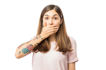 Portrait Of Shocked Young Woman Covering Mouth