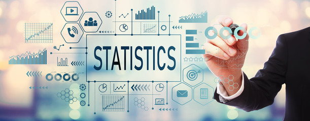 Statistics with businessman on blurred abstract background