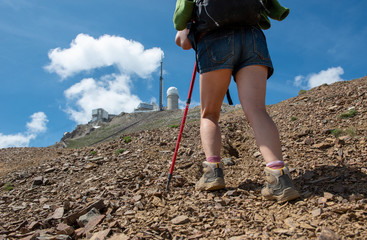 close up of legs hiker on the trail of Pic du Midi de Bigorre in the Pyrenees