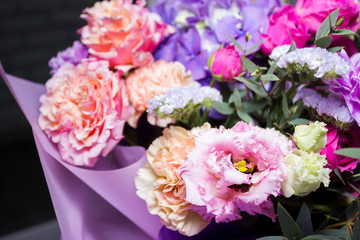 Colorful different flowers in vase at flower shop