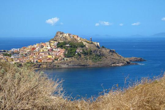 View over the blue Mediterranean sea and the  picturesque historic town of Castelsardo, Sardinia, Italy