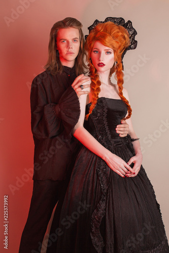 Gothic couple in halloween clothes  Pale vampire in