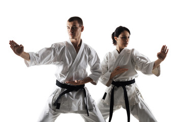 Foto op Aluminium Vechtsport karate girl and boy posing against white background