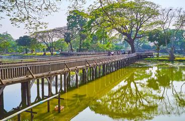 The old curved bridge in Kandawgyi park, Yangon, Myanmar