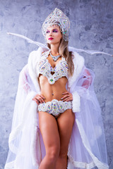 woman wearing a traditional Russian   hat and sparkling bikini