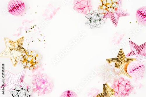 pastel pink confetti bows and paper decorations flat lay top view holiday