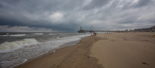 The beach of Scheveningen overlooking the old pier with bungy-tower, Netherlands