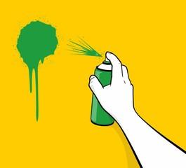 Man hand using green spray painting