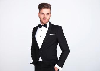 portrait of relaxed elegant man in black tuxedo