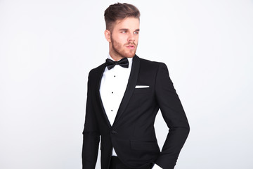 portrait of stylish curious man looking to side