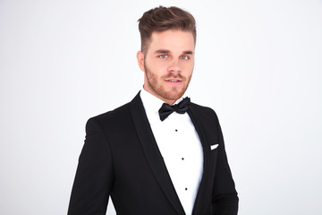 portrait of smiling gentleman in black tuxedo