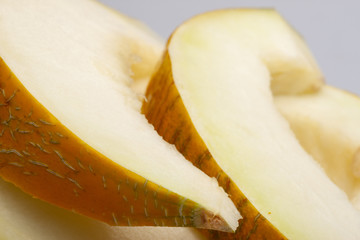 One yellow honeydew melon slice without seeds