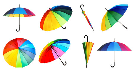 Wall Mural - Set with elegant rainbow umbrella from different views on white background