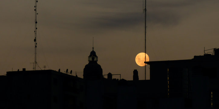 Barolo Building at dusk with full moon in Buenos Aires, Argentina.