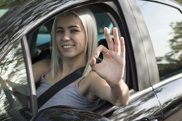 happy young girl driving the car