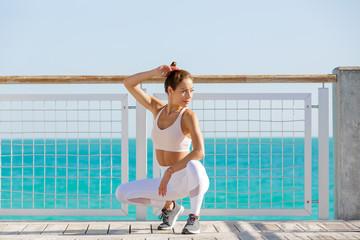 Attractive latina girl looking away on the bridge of Miami Beach