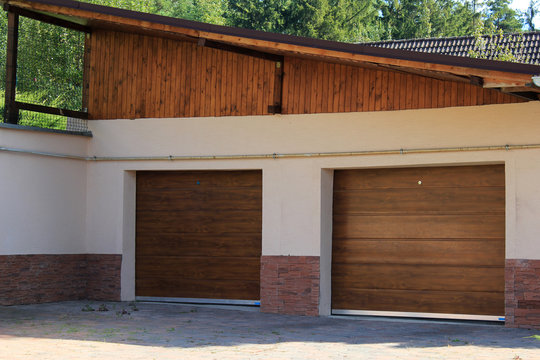 The garage wall with two wide doors
