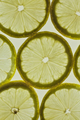 Orange thinly sliced lobules lies on a white background, juicy, tasty citrus, sweet juice.