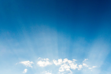 Blue sky cloudscape and white clouds background with sunbreams