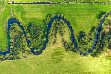 Tuinposter Rivier Aerial view on winding river in rural landscape