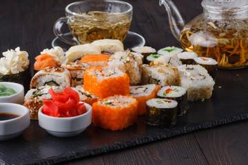 sushi rolls on board ginger wasabi