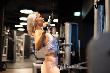 Woman doing exercise in gym