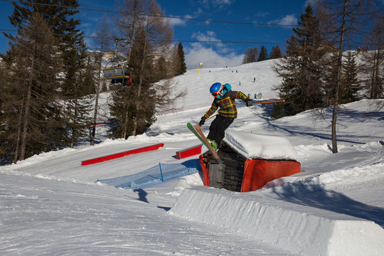 Skier in Action: Ski Jumping in the Mountain Snowpark