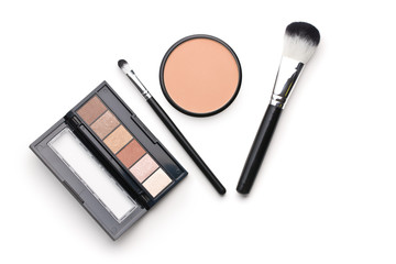 The makeup products. Brush and eyeshadow powder.