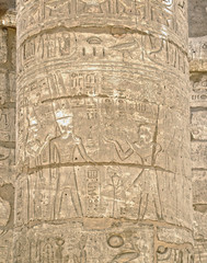 Ancient Egyptian hieroglyphs and scriptures on the stone columns of the Karnak Temple in Luxor