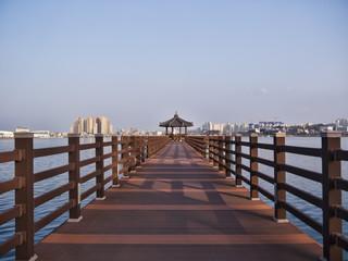 Long pier and korean traditional pavilion . Sokcho city, South Korea