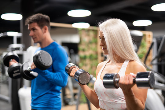 Man and woman working out in gym