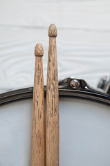 Musical instruments close up. Beautiful snare drum with drummer holding drumsticks