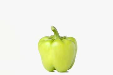 Green pepper on white background. Colorful paprika isolated.
