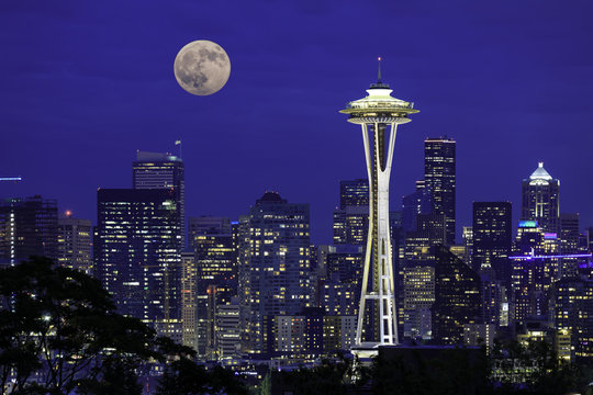 Full moon rising over the city of Seattle