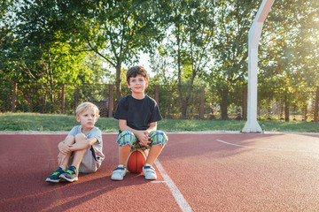 Two Little Boys Playing Basketball