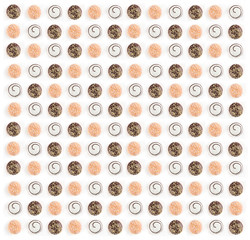 Ensemble of many glazed and assorted doughnuts side by side isolated on white background, top view
