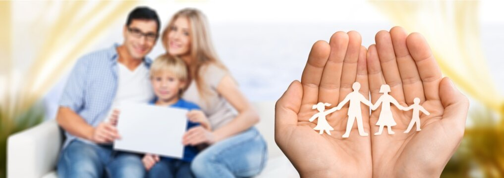 Hands with paper family, happy family concept
