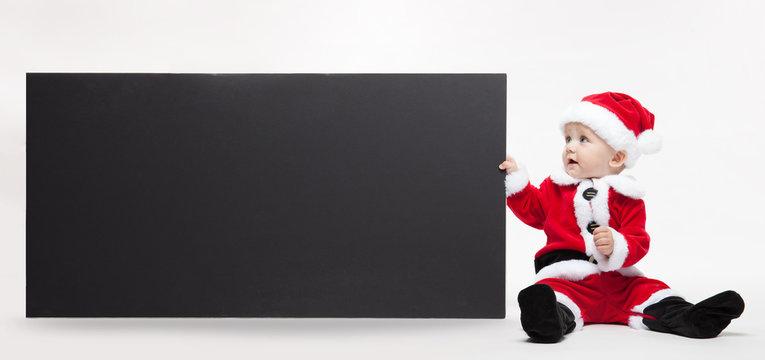 Santa Claus baby hold black advertisment banner blank