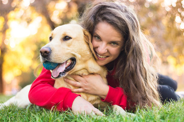 Young smiling woman with her dog