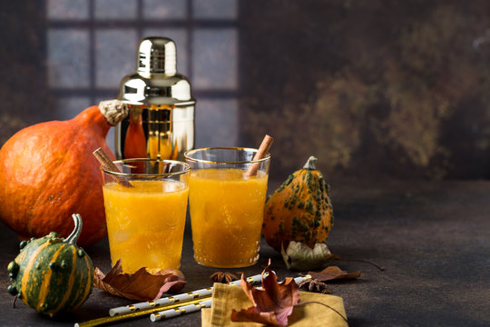 Fall Thanksgiving and Halloween Cocktail. Pumpkin Cocktail.
