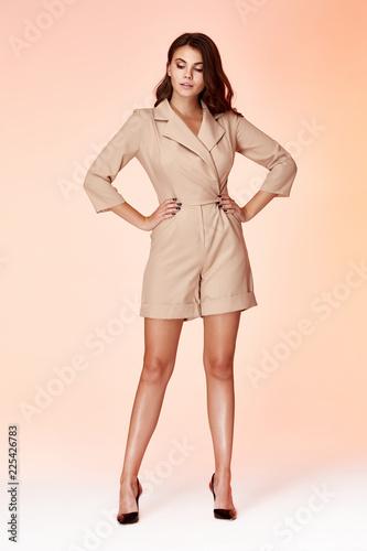 379fd76dd8b72 Sexy beauty fashion model brunette hairstyle wear beige short suit luxury  accessory bag jewelry style for