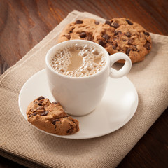 Cup of coffee and cookies on the table