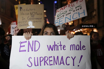Demonstrators hold signs during a protest and march against the U.S. Supreme Court nominee Brett Kavanaugh in New York City