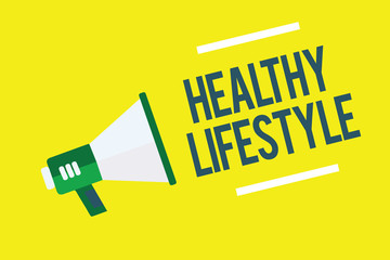 Writing note showing Healthy Lifestyle. Business photo showcasing Live Healthy Engage in physical activity and exercise Megaphone yellow background important message speaking loud