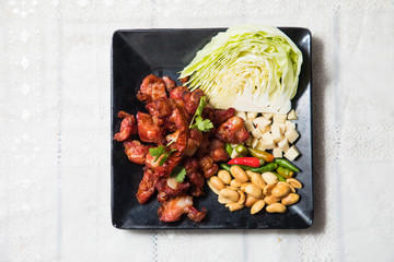 Favorite preservation food in thailand, Fried sour pork, fermented pork, vegetable and chili on dish