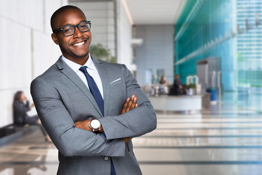 Smiling happy and successful CEO business man corporate executive in large downtown building