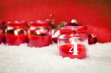 vierter advent mit Kerze im glas