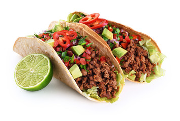 Mexican tacos with beef, tomatoes, avocado, chilli and onions isolated on white background. Wall mural