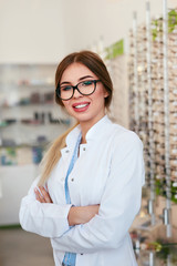 Optician Woman At Eyeglasses Store Portrait